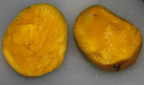 Halved mango left without seed-right still in fruit...just go for it.